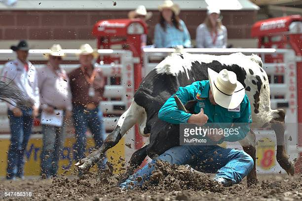 Travis Reay from Mayerthorpe AB during Steer Wrestling competition at the Calgary Stampede 2016 Twenty of the world's top competitors in each of the...