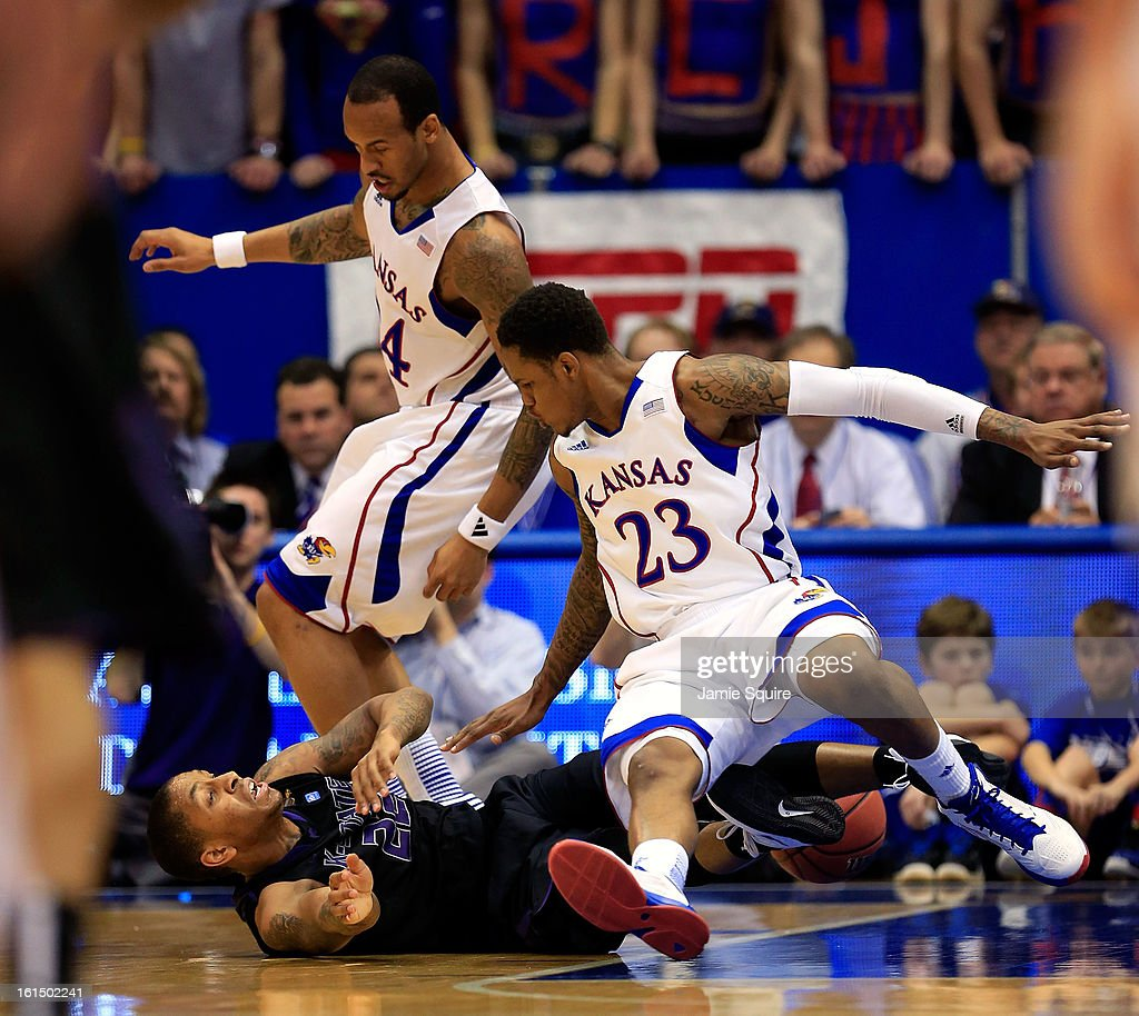 Travis Releford #24 and Ben McLemore #23 of the Kansas Jayhawks battle Rodney McGruder #22 of the Kansas State Wildcats for a loose ball during the game at Allen Fieldhouse on February 11, 2013 in Lawrence, Kansas.