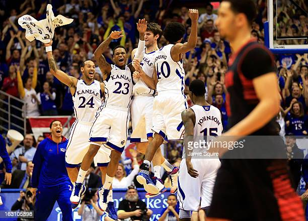 Travis Releford Ben McLemore Jeff Withey and Kevin Young of the Kansas Jayhawks celebrate after Withey hit a threepointer during the game against the...