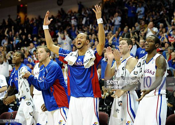 Travis Releford of the Kansas Jayhawks and teammates on the bench celebrate late in their 98-41 victory over the Ohio Bobcats during the third round...
