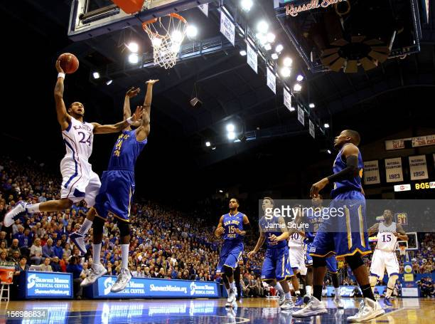 Travis Releford of the Kansas Jayhawks shoots over the San Jose State Spartans during the game at Allen Fieldhouse on November 26, 2012 in Lawrence,...
