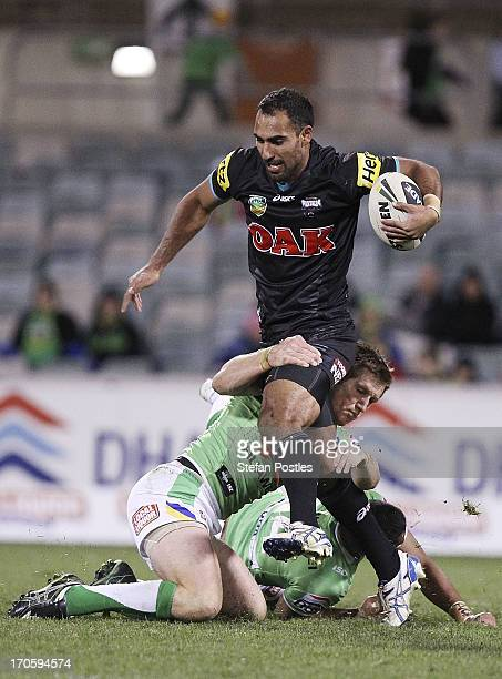 Travis Robinson of the Panthers is tackled during the round 14 NRL match between the Canberra Raiders and the Penrtih Panthers at Canberra Stadium on...