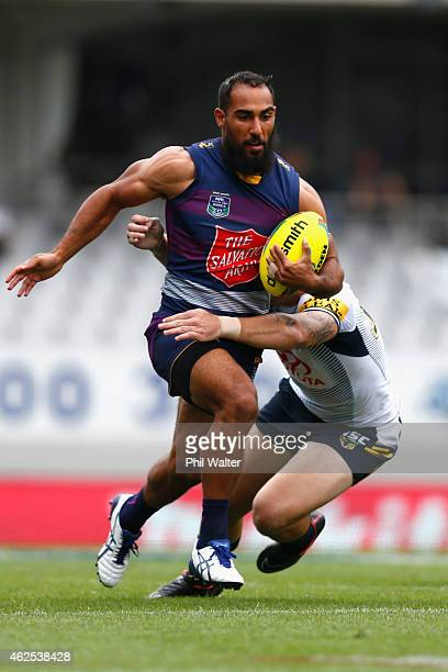 Travis Robinson of the Storm makes a break during the match between the Storm and the Cowboys in the 2015 Auckland Nines at Eden Park on January 31...