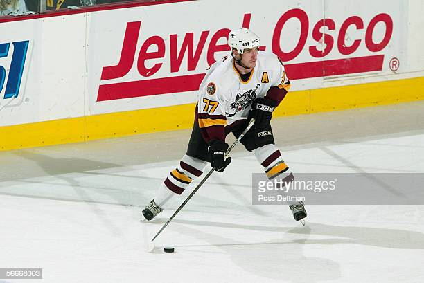 Travis Roche of the Chicago Wolves handles the puck against the Peoria Rivermen at Allstate Arena on December 11 2005 in Rosemont Illinois The Wolves...