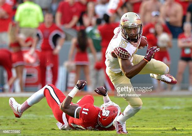 Travis Rudolph of the Florida State Seminoles breaks away from Juston Burris of the North Carolina State Wolfpack during their game at CarterFinley...