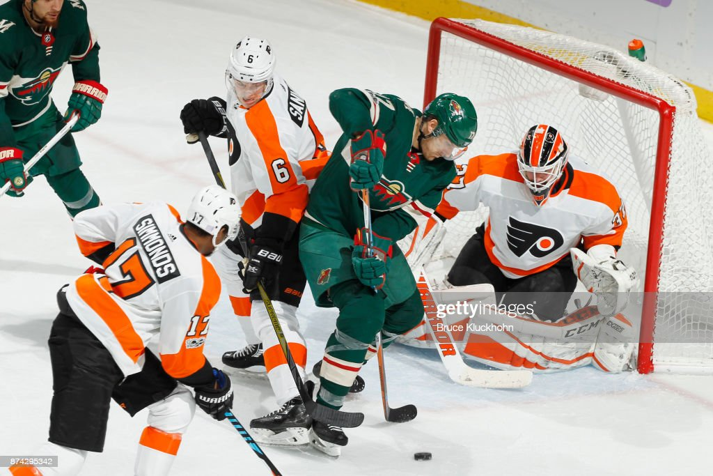 Travis Sanheim #6 and goalie Brian Elliott #37 of the Philadelphia Flyers defend their goal against Marcus Foligno #17 of the Minnesota Wild during the game at the Xcel Energy Center on November 14, 2017 in St. Paul, Minnesota.