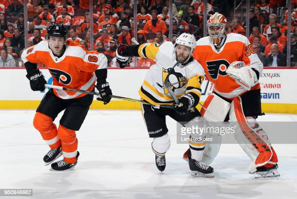 Travis Sanheim and Michal Neuvirth of the Philadelphia Flyers battle against Bryan Rust of the Pittsburgh Penguins in Game Four of the Eastern...