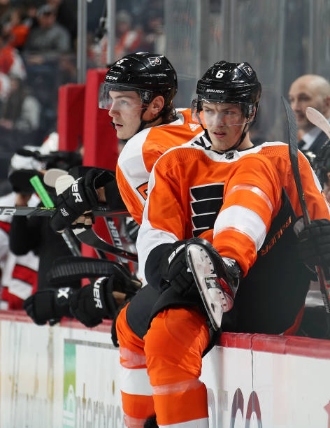 Travis Sanheim and Philippe Myers of the Philadelphia Flyers jump to the ice on a shift change against the Carolina Hurricanes on November 5, 2019 at...