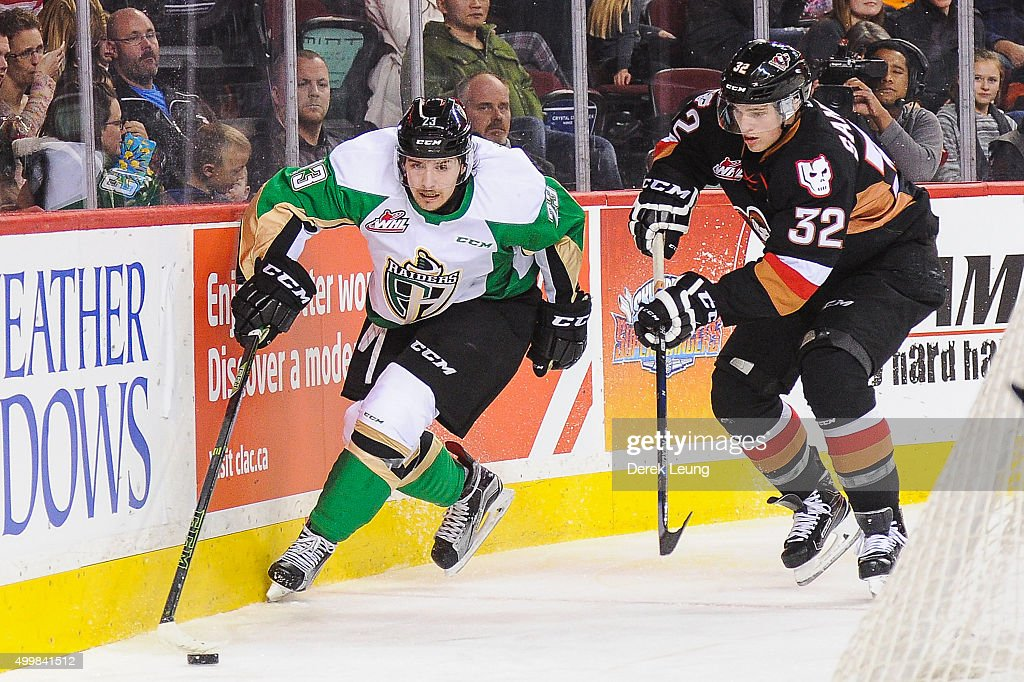 Travis Sanheim #32 of the Calgary Hitmen chases Simon Stransky #23 of the Prince Albert Raiders during a WHL game at Scotiabank Saddledome on December 3, 2015 in Calgary, Alberta, Canada.