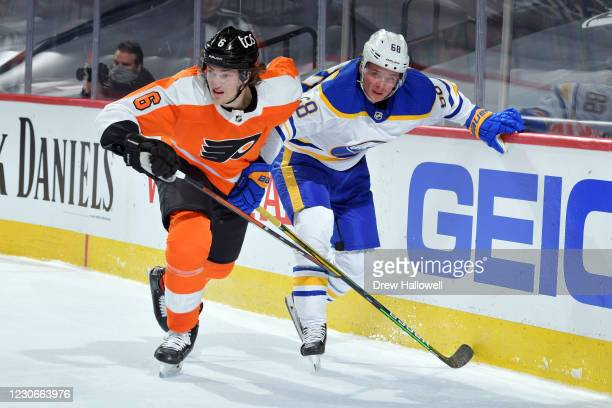 Travis Sanheim of the Philadelphia Flyers and Victor Olofsson of the Buffalo Sabres skate to the puck in the second period at Wells Fargo Center on...