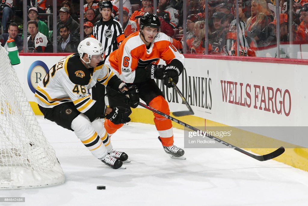 Travis Sanheim #6 of the Philadelphia Flyers battles for the loose puck behind the net with David Krejci #46 of the Boston Bruins on December 2, 2017 at the Wells Fargo Center in Philadelphia, Pennsylvania.