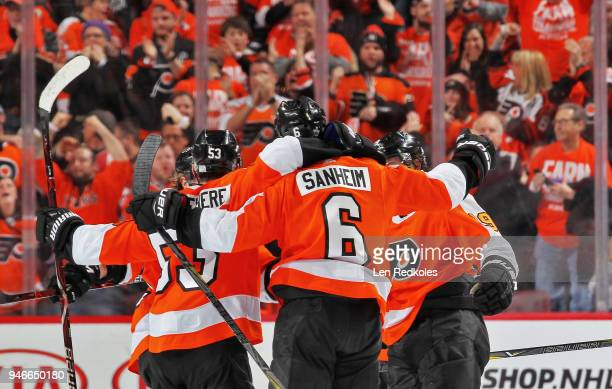 Travis Sanheim of the Philadelphia Flyers celebrates his second period goal against the Pittsburgh Penguins with Shayne Gostisbehere and Nolan...