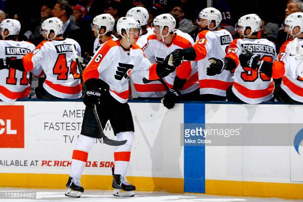Travis Sanheim of the Philadelphia Flyers is congratulated by his teammates after scoring a first period goal against the New York Islanders at NYCB...