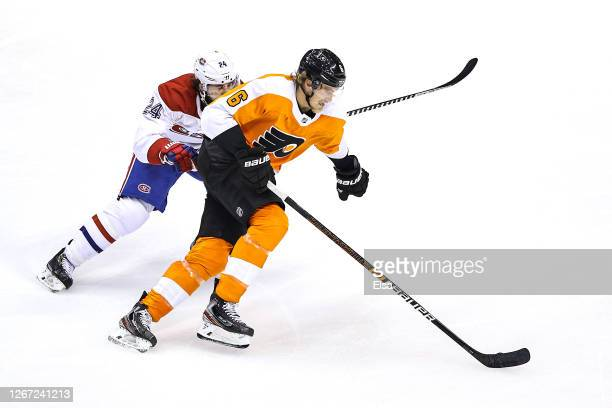 Travis Sanheim of the Philadelphia Flyers is pursued by Phillip Danault of the Montreal Canadiens during the second period in Game Five of the...