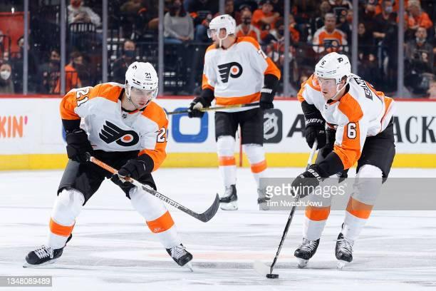 Travis Sanheim of the Philadelphia Flyers looks to pass against the Boston Bruins at Wells Fargo Center on October 20, 2021 in Philadelphia,...