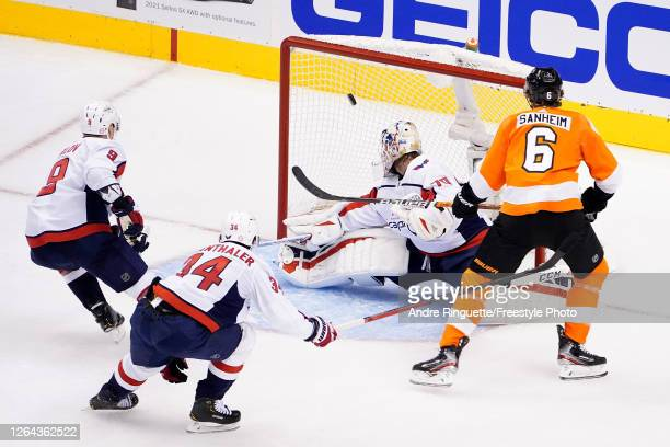 Travis Sanheim of the Philadelphia Flyers scores a goal on Braden Holtby of the Washington Capitals during the second period in the Eastern...