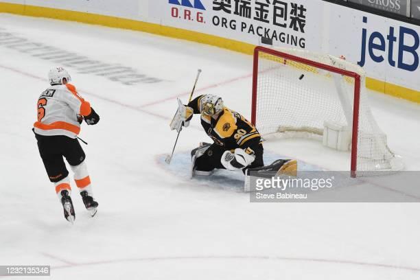Travis Sanheim of the Philadelphia Flyers scores in overtime against the Boston Bruins at the TD Garden on April 5, 2021 in Boston, Massachusetts.