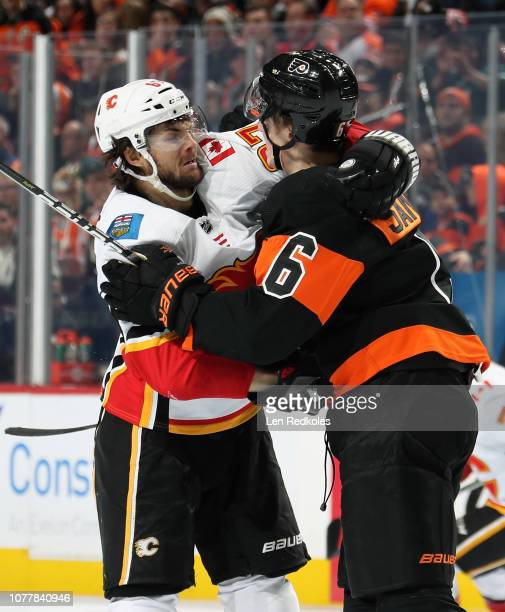 Travis Sanheim of the Philadelphia Flyers scuffles with Michael Frolik of the Calgary Flames on January 5 2019 at the Wells Fargo Center in...