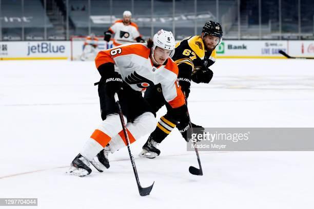 Travis Sanheim of the Philadelphia Flyers skates against Jakub Zboril of the Boston Bruins during overtime at TD Garden on January 21, 2021 in...