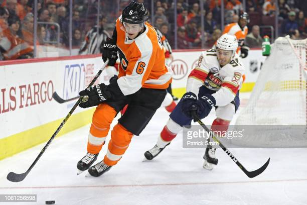 Travis Sanheim of the Philadelphia Flyers skates past Juho Lammikko of the Florida Panthers during the third period at Wells Fargo Center on November...