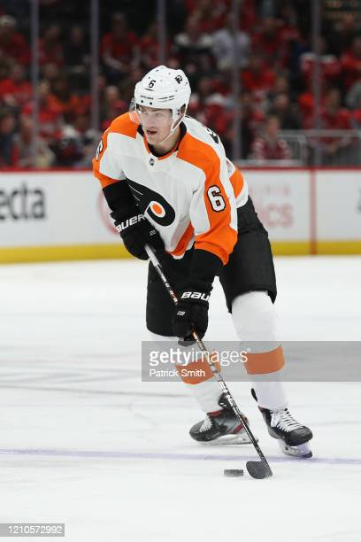 Travis Sanheim of the Philadelphia Flyers skates with the puck against the Washington Capitals during the first period at Capital One Arena on March...
