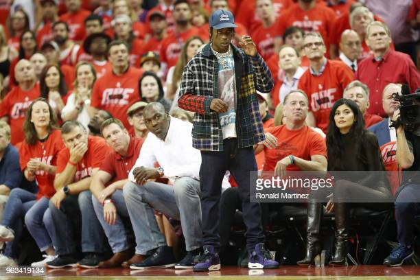 Travis Scott and Kylie Jenner attend Game Seven of the Western Conference Finals of the 2018 NBA Playoffs between the Houston Rockets and the Golden...