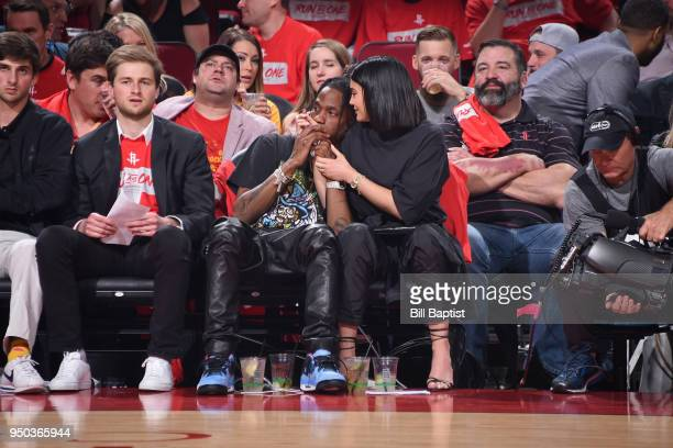 Travis Scott and Kylie Jenner attend Game Two of Round One between the Minnesota Timberwolves and the Houston Rockets during the 2018 NBA Playoffs on...