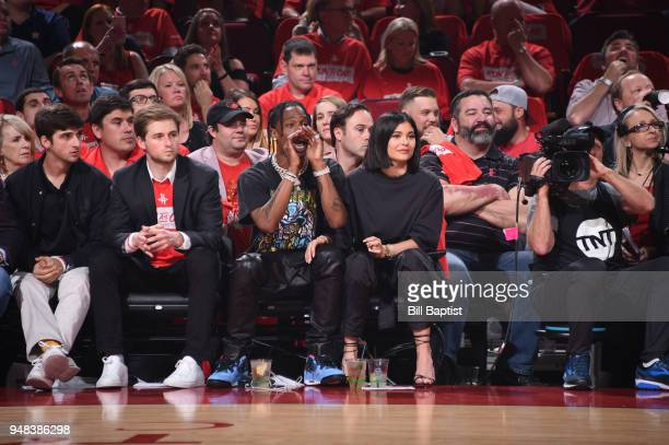 Travis Scott and Kylie Jenner cheer as they watch the Houston Rockets against the Minnesota Timberwolves during Game Two of Round One of the 2018 NBA...