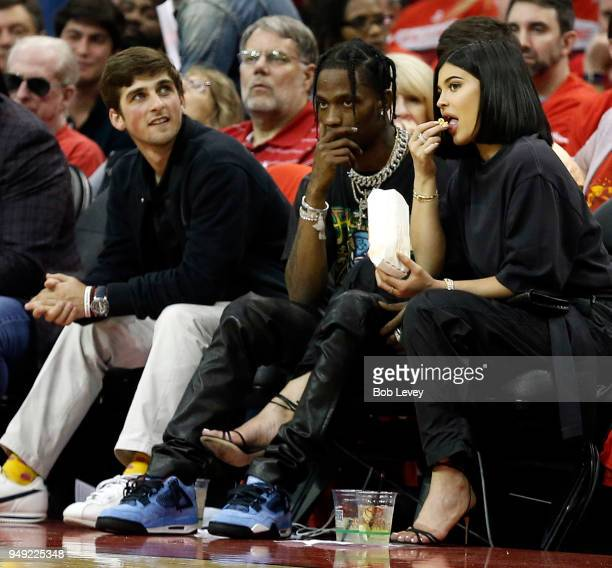 Travis Scott and Kylie Jenner sit courtside during Game Two of the first round of the Western Conference playoffs at Toyota Center on April 18 2018...