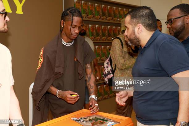 Travis Scott attends the launch of the 'Reese's Puffs' pop up store on June 25 2019 in Paris France