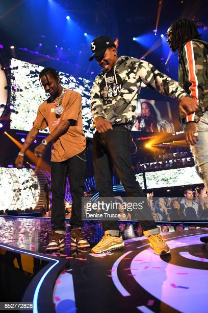 Travis Scott Chance The Rapper and Quavo perform onstage during the 2017 iHeartRadio Music Festival at TMobile Arena on September 23 2017 in Las...