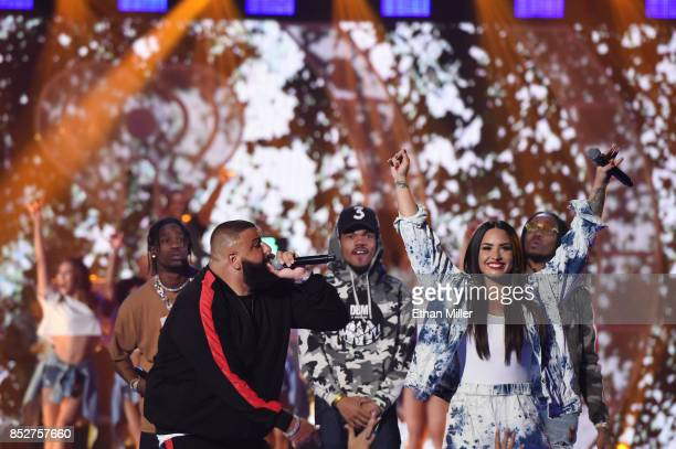 Travis Scott DJ Khaled Chance the Rapper Demi Lovato and Quavo of Migos perform onstage during the 2017 iHeartRadio Music Festival at TMobile Arena...