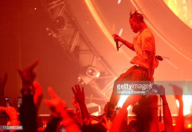 Travis Scott skips across the stage during his performance at Spectrum Center in Charlotte NC on Sunday March 24 2019 Scott's performance was part of...