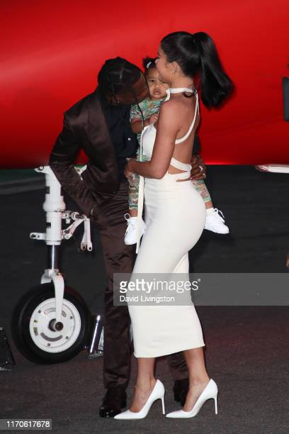 "Travis Scott, Stormi Webster, and Kylie Jenner attend the premiere of Netflix's ""Travis Scott: Look Mom I Can Fly"" at Barker Hangar on August 27,..."