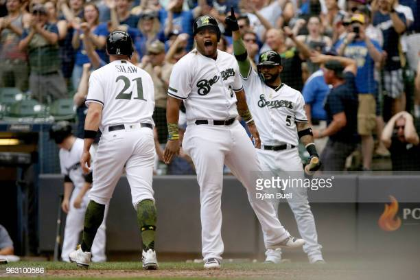 Travis Shaw and Jesus Aguilar of the Milwaukee Brewers celebrate after scoring runs in the seventh inning against the New York Mets at Miller Park on...