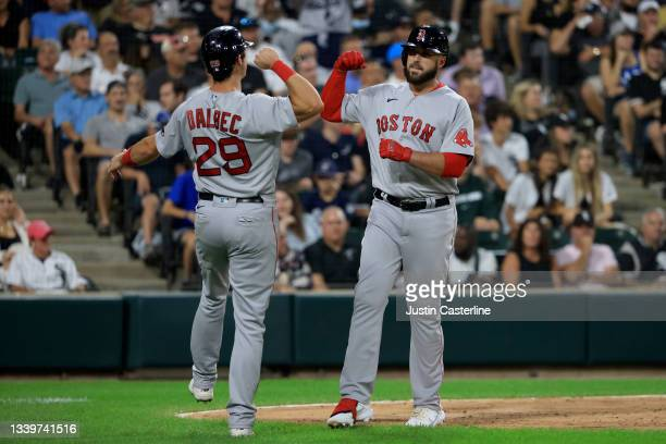 Travis Shaw celebrates with Bobby Dalbec of the Boston Red Sox after hitting a three run home run against the Chicago White Sox at Guaranteed Rate...