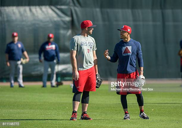 Travis Shaw left and Mookie Betts of the Boston Red Sox talk during a Spring Training workout on February 18 2016 at Fenway South in Fort Myers...