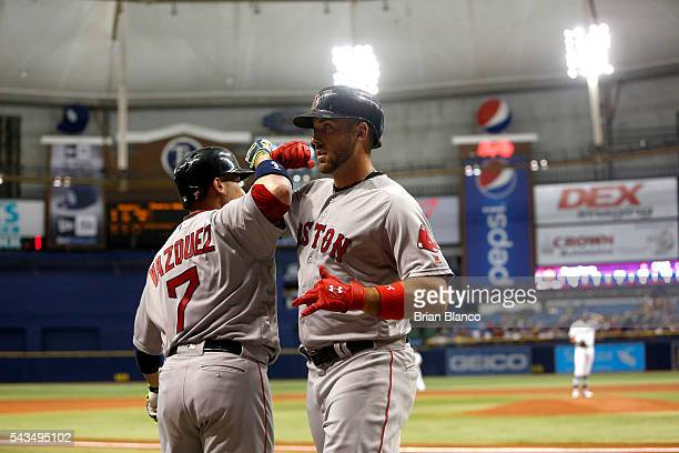 Travis Shaw of the Boston Red Sox celebrates his home run with teammate Christian Vazquez during the second inning of a game against the Tampa Bay...