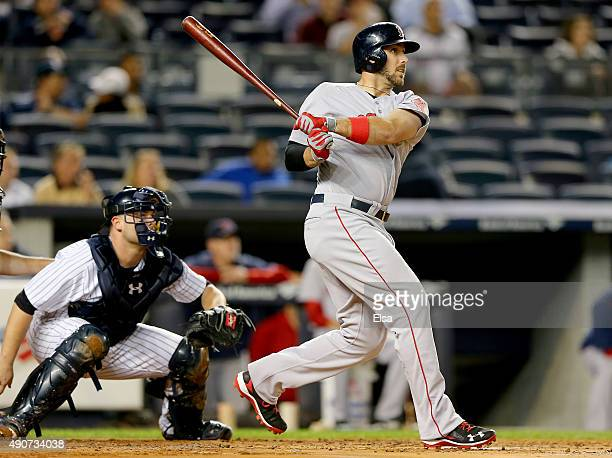 Travis Shaw of the Boston Red Sox hits a three run home run in the first inning as Brian McCann of the New York Yankees defends on September 30 2015...