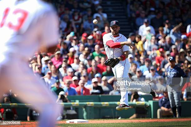 Travis Shaw of the Boston Red Sox makes a throw to first in the third inning during the game against the Tampa Bay Rays at Fenway Park on April 21...