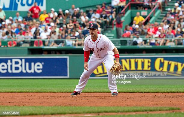 Travis Shaw of the Boston Red Sox stands at first base during the first inning against the Kansas City Royals at Fenway Park on August 23 2015 in...