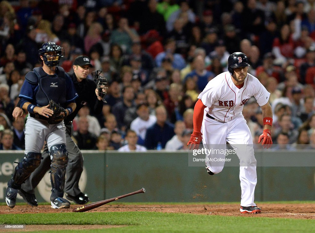 Travis Shaw #47 of the Boston Red Sox takes off for a double in the fourth inning against the Tampa Bay Rays at Fenway Park on September 21, 2015 in Boston, Massachusetts.