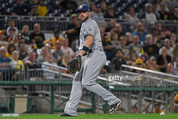 Travis Shaw of the Milwaukee Brewers cannot come up with a ball off the bat of Starling Marte of the Pittsburgh Pirates in the sixth inning during...