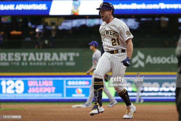 Travis Shaw of the Milwaukee Brewers celebrates after driving in the winning run during the eleventh inning against the Los Angeles Dodgers at...