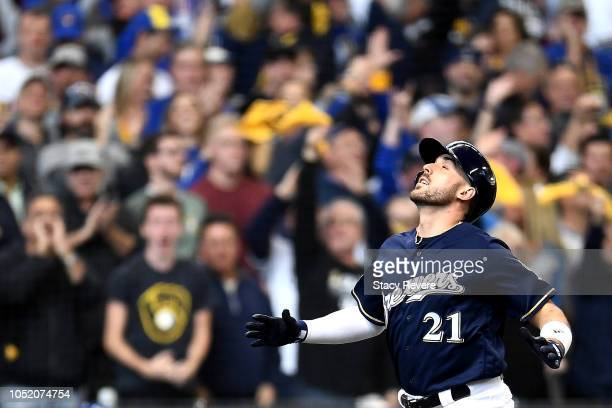 Travis Shaw of the Milwaukee Brewers celebrates after hitting a solo home run against Alex Wood of the Los Angeles Dodgers during the sixth inning in...