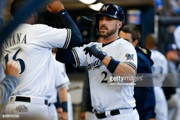 Travis Shaw of the Milwaukee Brewers celebrates his home run in the dugout during the sixth inning against the Miami Marlins at Miller Park on...