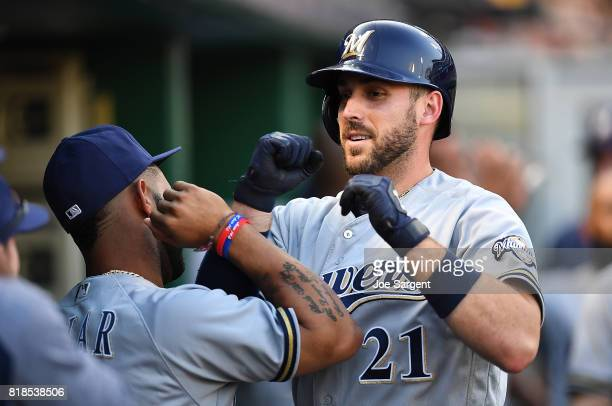 Travis Shaw of the Milwaukee Brewers celebrates his three run home run with Jonathan Villar during the third inning against the Pittsburgh Pirates at...