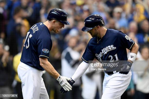 Travis Shaw of the Milwaukee Brewers celebrates with Erik Kratz after hitting a solo home run against Alex Wood of the Los Angeles Dodgers during the...