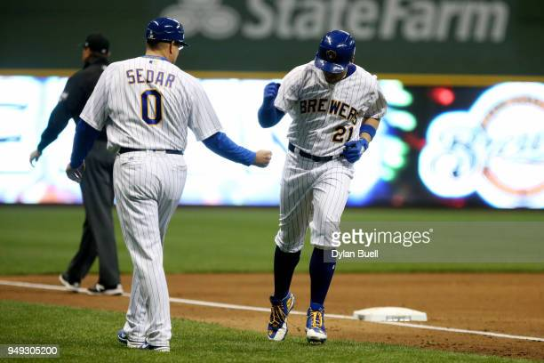 Travis Shaw of the Milwaukee Brewers celebrates with third base coach Ed Sedar after hitting a home run in the fourth inning against the Miami...
