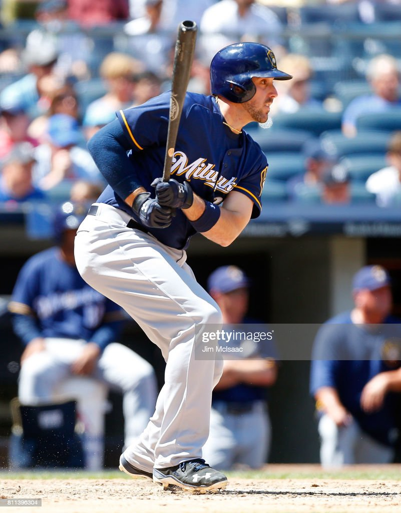 Travis Shaw #21 of the Milwaukee Brewers follows through on a fifth inning run scoring base hit against the New York Yankees at Yankee Stadium on July 9, 2017 in the Bronx borough of New York City.